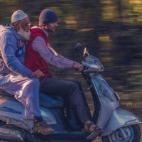 Panning Shot of a Scooter Riders